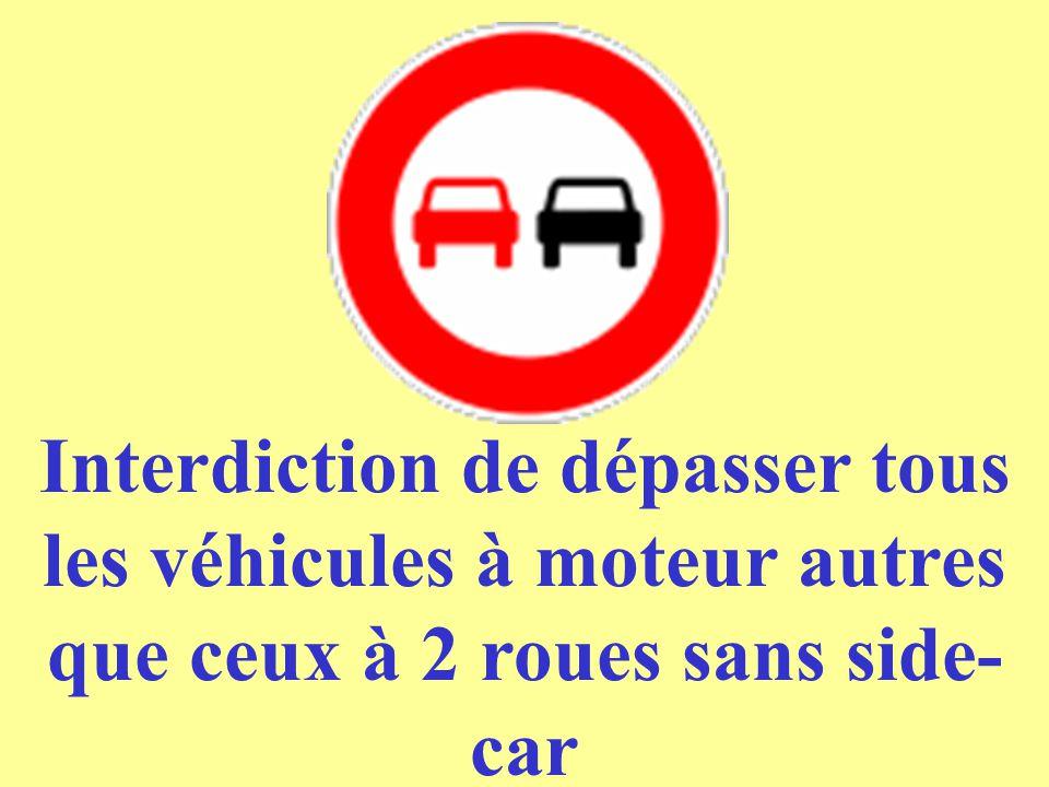 Interdiction de dépasser tous les véhicules à moteur autres que ceux à 2 roues sans side-car