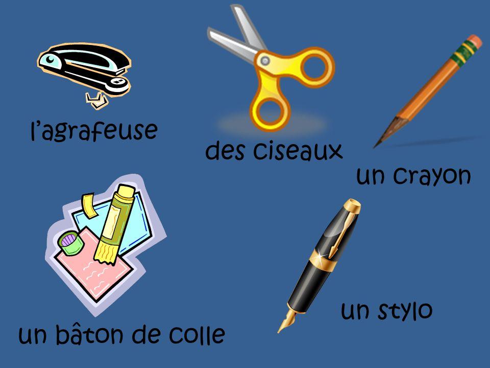 l'agrafeuse des ciseaux un crayon un stylo un bâton de colle