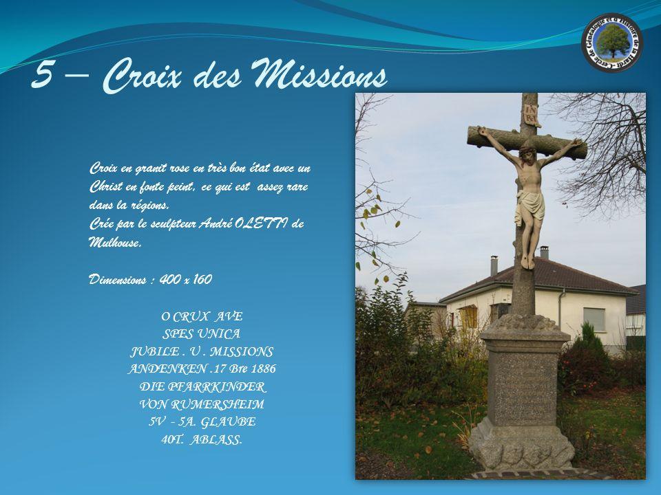 5 – Croix des Missions Croix en granit rose en très bon état avec un Christ en fonte peint, ce qui est assez rare dans la régions.